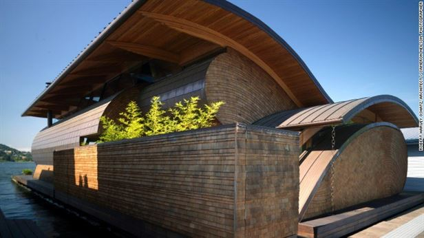 Residence, פורטלנד - יושב בחינניות על נהר Willamette בפורטלנד, אורגון. גגות מתעקלים מחקים את האדוות במים