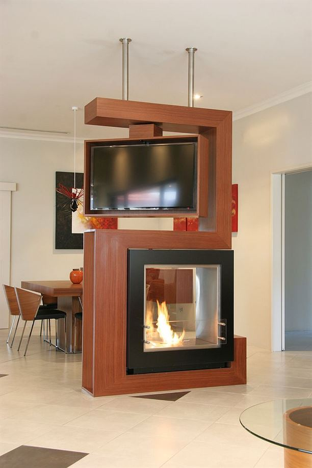 Awesome-room-divider-holds-turnable-TV-and-fireplace
