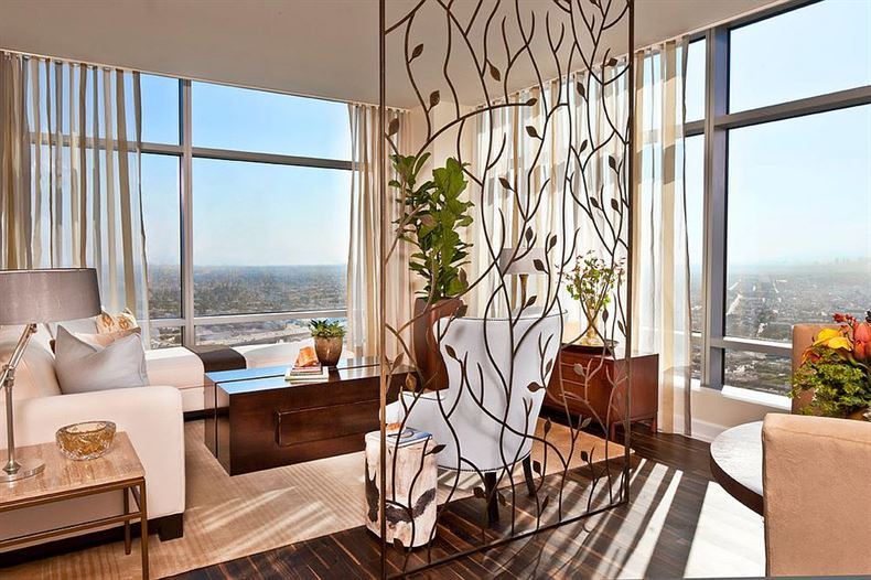 Custom-crafted-room-divider-brings-a-hint-of-artistic-beauty-to-the-living-room