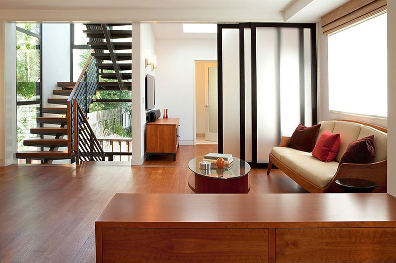 Custom-doors-used-as-room-dividers-can-be-folded-away-when-not-needed