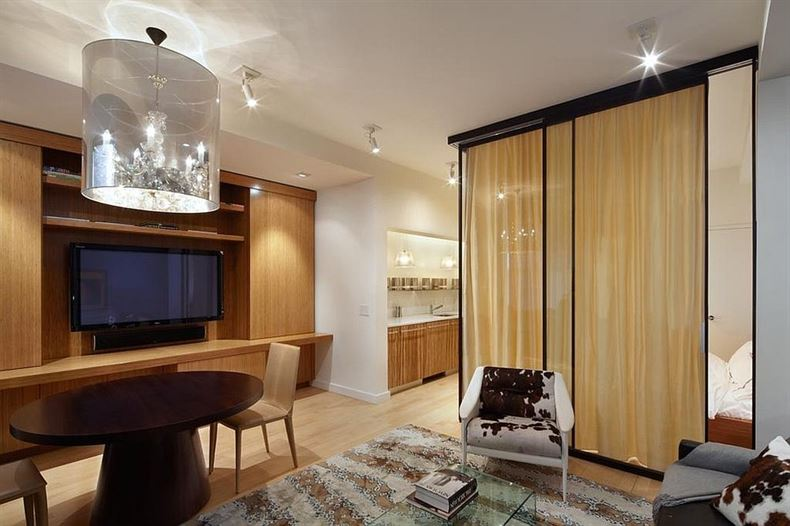 Custom-glass-wall-room-divider-with-drapes-encloses-the-bedroom