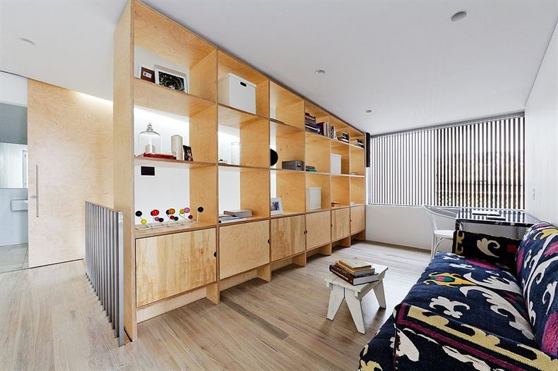 Make-the-most-out-of-your-room-divider-by-using-it-as-a-display-and-storage-unit