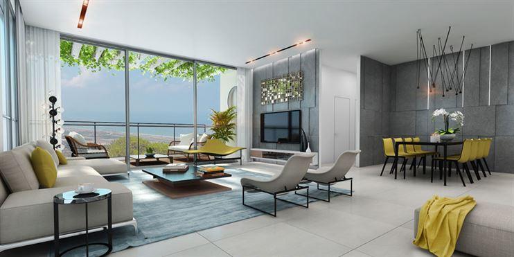חלל המגורים בדירה מואר ומאוורר משלוש כיווני אויר