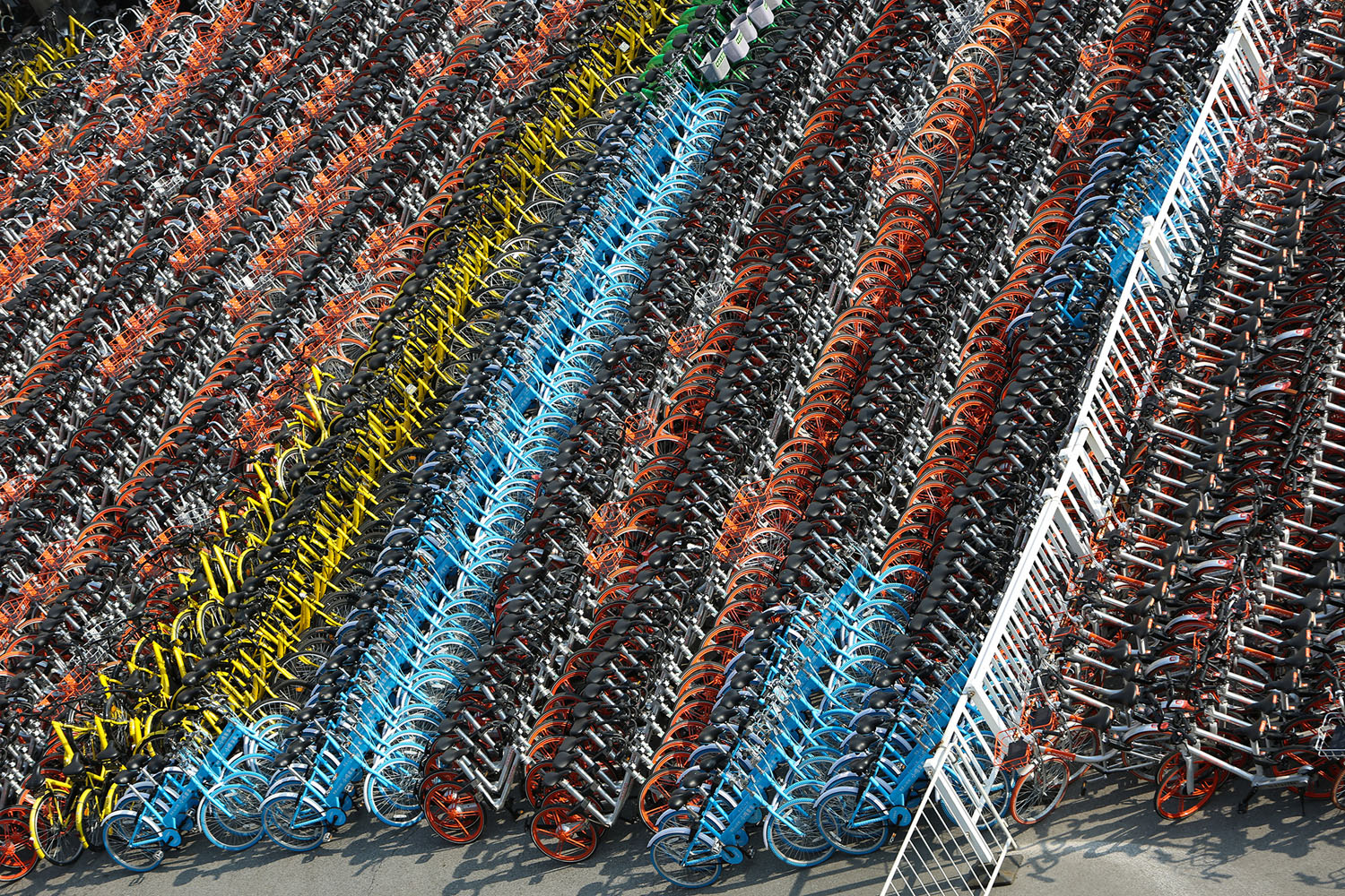 Confiscated sharing bicycles of different brands are seen at a parking lot of Huangpu District Vehicle Management Company in Shanghai