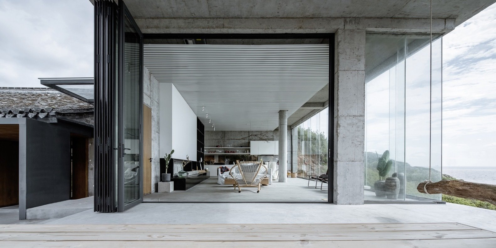 a-massive-folding-glass-wall-opens-to-connect-an-open-plan-living-area-to-the-outdoors