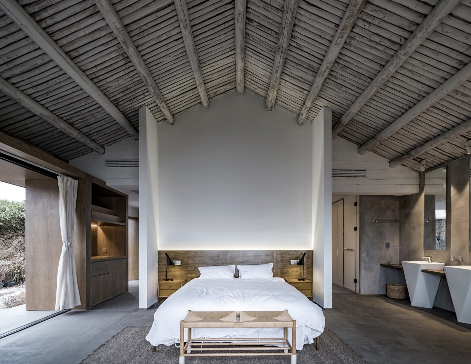 a-timber-beamed-ceiling-adds-a-rustic-touch-to-the-modern-master-suite
