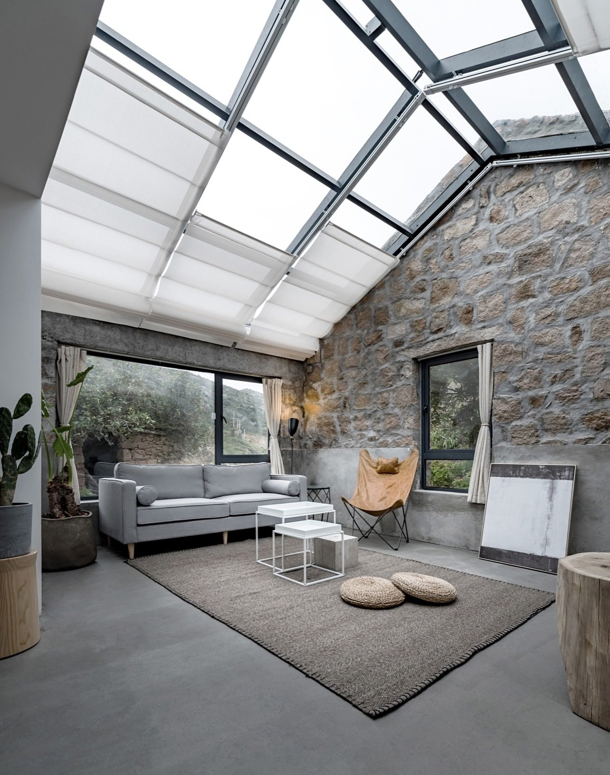formerly-used-as-a-kitchen-the-space-next-to-the-master-bedroom-has-been-turned-into-a-living-area-retractable-shades-cover-the-gla