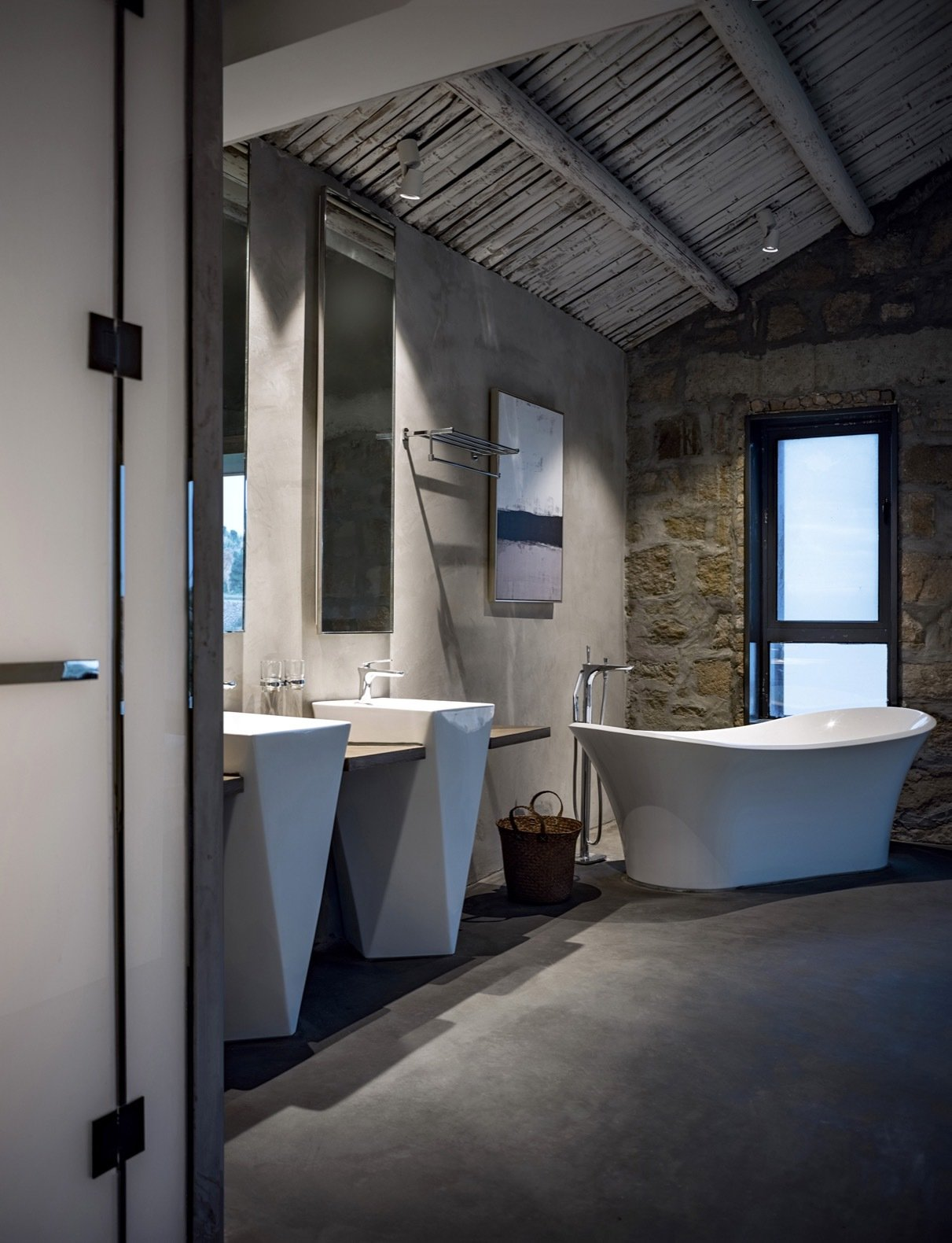 in-contrast-to-the-historic-setting-the-master-bathroom-is-outfitted-with-modern-fixtures-including-a-double-vanity-freestanding-tu
