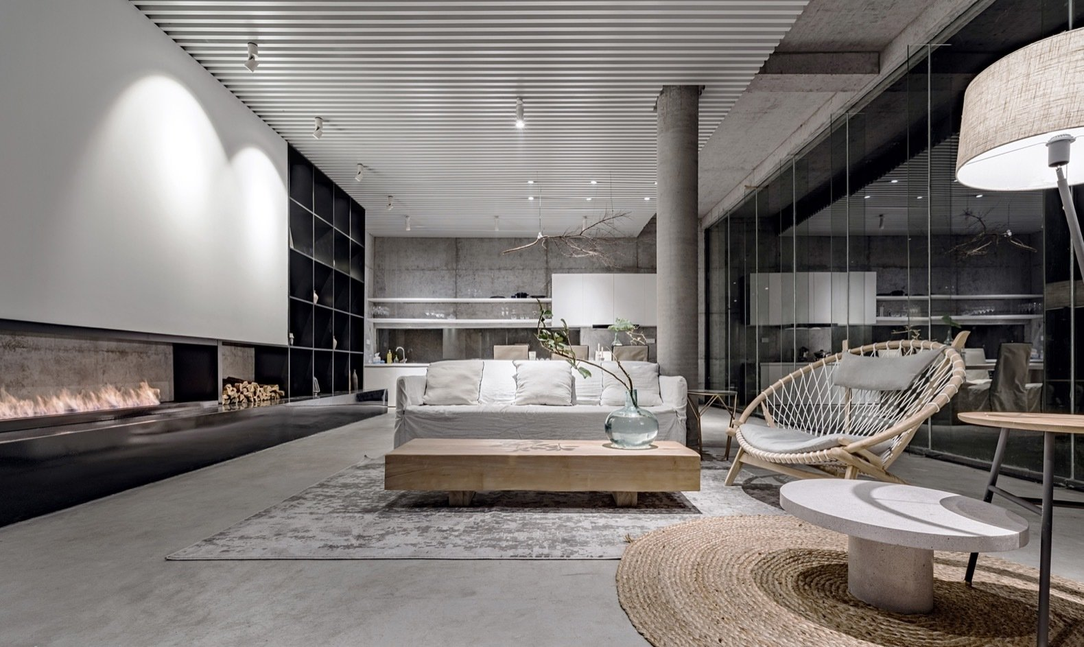 seen-at-night-the-sumptuous-living-area-features-modern-furnishings-and-a-long-wood-burning-fireplace
