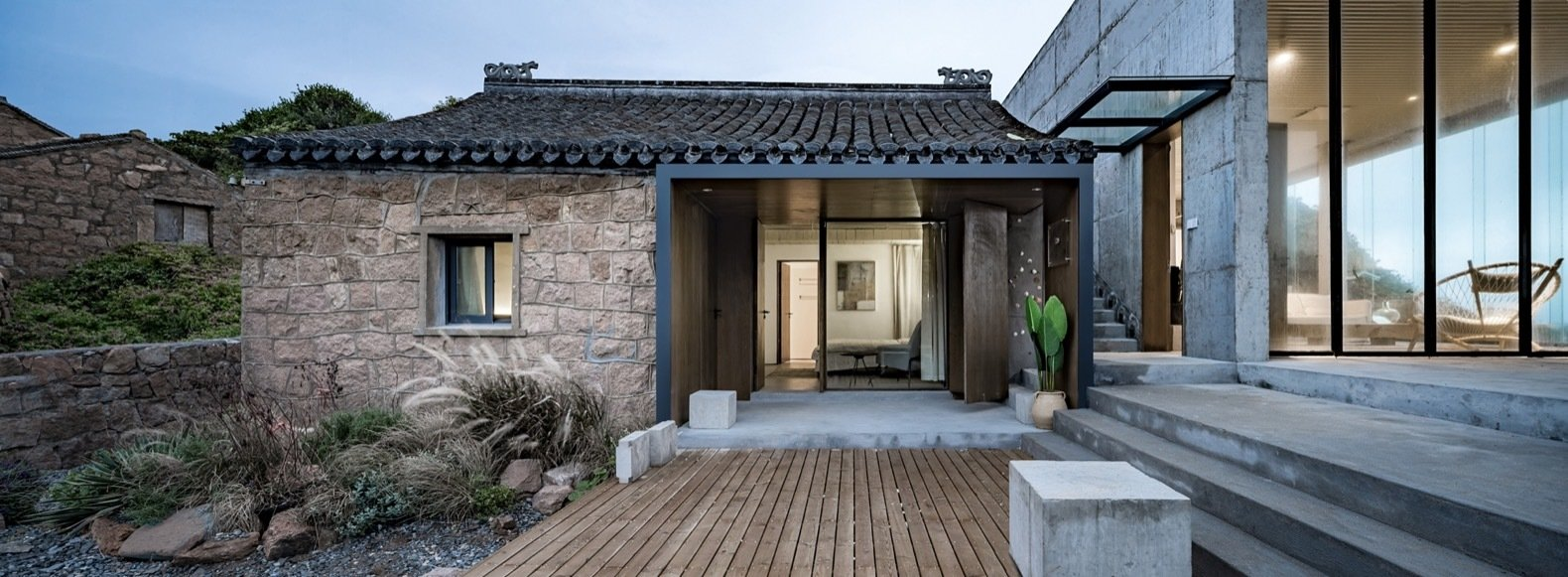 the-smaller-of-the-two-existing-buildings-this-renovated-structure-houses-two-bedrooms-a-glass-overhang-was-installed-above-the-pas